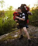Young happy father traveling with little son and huge backpack, lifestyle people Stock Photos