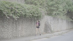 Pretty brunette fitness woman running outdoors Arkistovideo