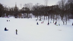 Park Visitors relax, ride on a sled, skis, boards in Moscow Stock Footage