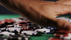 4K Hand collecting winnings in a game of poker, in slow motion Stock Footage