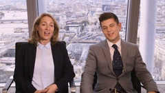 4K Happy business man and woman on video call in corporate city office Arkistovideo