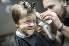Small kid in barbershop Stock Photos