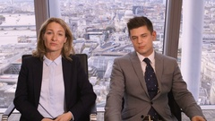 4K Bored business man and woman on video call in corporate city office Arkistovideo