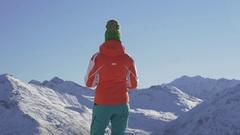 Woman looking afar on a snowy mountain peaks Stock Footage