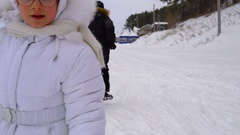 Teen boy is running on the road covered with snow. Stock Footage