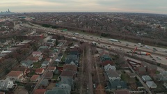 Busy Interstate with Neighborhood and Park Dolly back Stock Footage