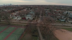 Neighborhood Park Busy Interstate Fly up Stock Footage