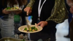 Picking food from hot buffet at the party Stock Footage