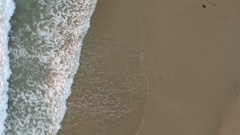 Aerial shot of young man running on the beach. Stock Footage