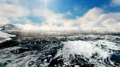 Cargo ship navigating at sea between aisberg Arkistovideo