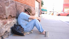 Unhappy Homeless Man Sitting in City Street Stock Footage