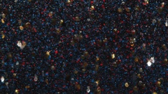 Abstract Background Red and Blue Droplets and Gold Flakes Slowly Float in Space Stock Footage