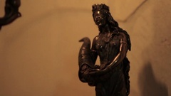 Copper statue of the goddess of women who mystically flickers the fire Stock Footage
