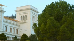 Spruce and bushes on a background of the Livadia Palace Stock Footage