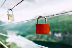 Red padlock and Geirangerfjord from Flydasjuvet viewpoint Norway Stock Photos