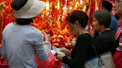 HONG KONG Woman market stall holder sells Chinese New Year Decoration Stock Footage