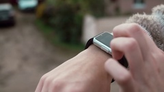 Woman using her smartwatch touchscreen device on a countryside background 4k Stock Footage