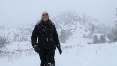 Woman Walking Through A Winter Wonderland Stock Footage