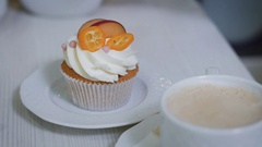 The man gently breaks off a piece of cupcakes with butter cream from spoon wch Stock Footage
