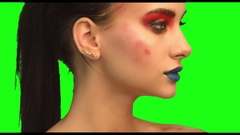 Beautiful brunette face close up portrait on green screen Stock Footage