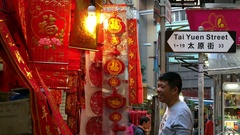 HONG KONG Chinese New year red cards & man Stock Footage