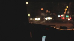 View out a windshield driving at night. Shallow depth of field. Stock Footage