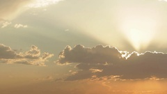 Woman Stands Under God Rays Shining Through Sunset Cloud Stock Footage