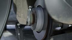 Man installing winter wheel tire on his car Stock Footage