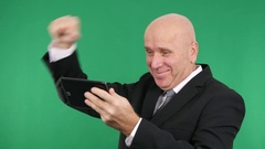 Happy Salesman Using Touch Tablet Receive Good News Make Enthusiastic Gestures. Stock Footage