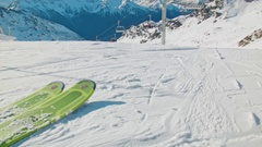 Handheld slowmotion people starting to ski of the white snowy mountains Stock Footage