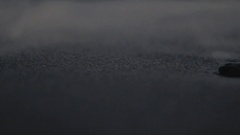 Wet grey sand and smooth rocks at sunset Stock Footage