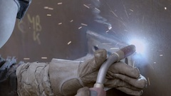 Construction worker welds a pipe Stock Footage