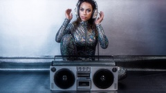 Stereo ghettoblaster cute female sexy music disco club lifestyle catsuit Stock Footage