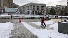 Workers remove snow on Maidan Independence Square in Kiev Stock Footage
