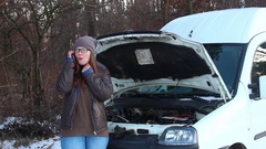 Woman with Broken Down Car on a country road Stock Footage
