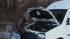 Woman with car trouble on a country road Stock Footage