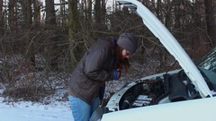 Woman and broken down car on a country road Stock Footage
