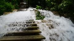 Flooded stairs at waterfall Kuang Si,  Luang Prabang,  Laos Stock Footage