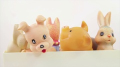 The vintage rubber toys in the plastic box Stock Footage