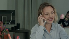 Happy female office worker talking on the phone and holding rose Stock Footage