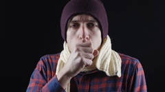Cough, Sick Young Man Coughing, Isolated. He warmly dressed and suffering from Stock Footage