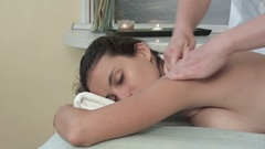 Beautiful young woman getting neck massage in a spa salon Stock Footage