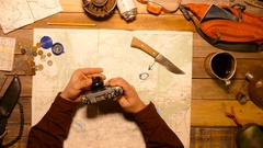 Traveler holding in hands and testing old photo camera. Top view. Stock Footage