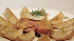 Chicken thighs with potatoes on a plate Stock Footage