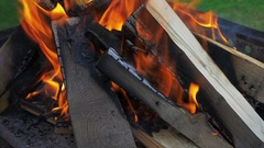 Sparks fire cracks in grill fire pit. Burning ash rise from large fire. Stock Footage