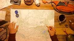 Traveler, tourist putting labels on hiker map Top view. Stock Footage