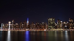Star and Aviation Trails over the New York City skyline and Midtown Manhattan Stock Footage
