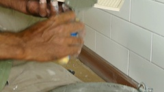 Man putting ceramic tile on the wall. Stock Footage