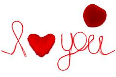 Love you words and heart symbol made of red thread on a white for your Vale.. Stock Photos