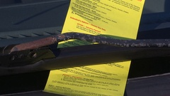Classic Toronto yellow parking ticket on car windshield Stock Footage